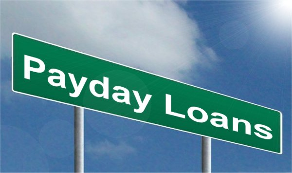 payday loans spelled out in white letters on a green road sign