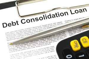 silver pen and black and yellow calculator lying on top of debt consolidation agreement